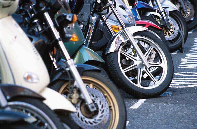 Row of Motorcycles Front Wheels